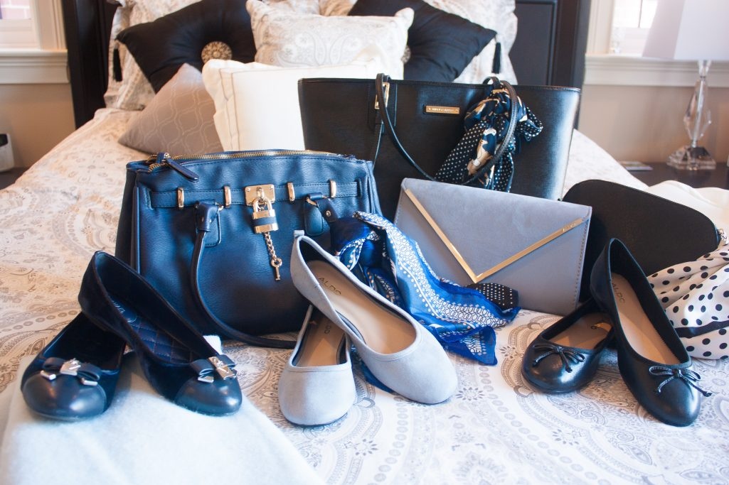 Navy, light blue, and black flats and purses assembly
