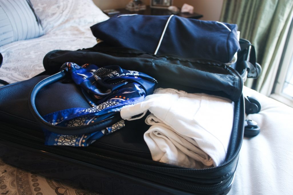 Clothes neatly packed in an open carry-on suitcase