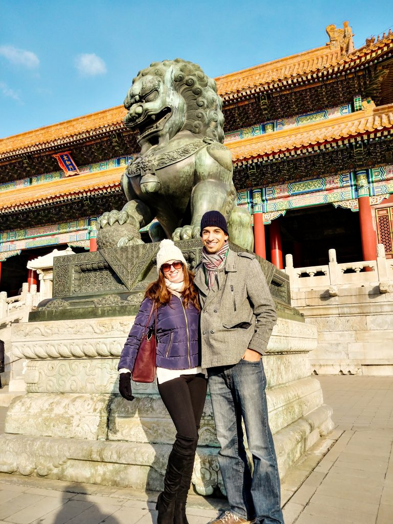 Kyle and Bettina in front of an imperial guardian lion at the forbidden city in Beijing
