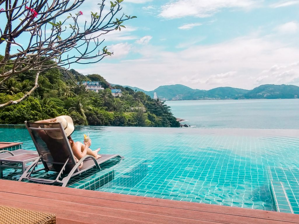 Bettina suntanning at the infinity pool at U Zenmaya hotel, Phuket, Thailand