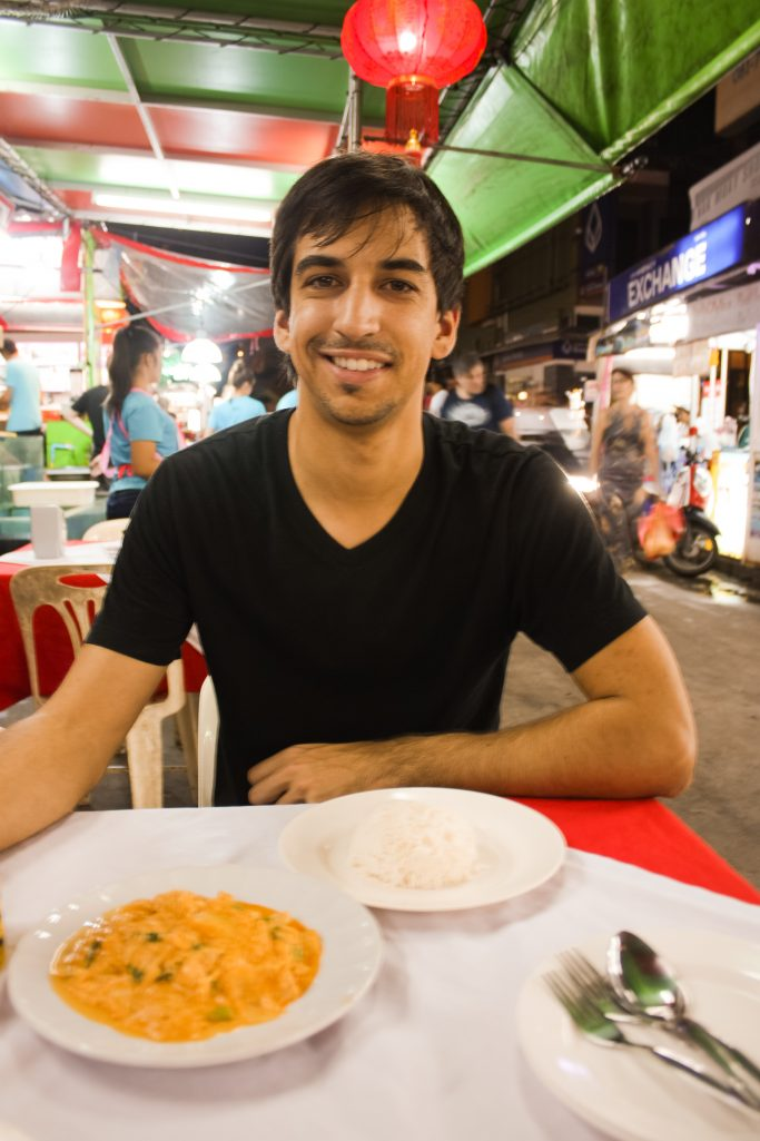 Kyle eating yellow curry at Patong Beach in Phuket, Thailand