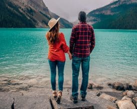 Coupe Standing at Lake Louise in Fall