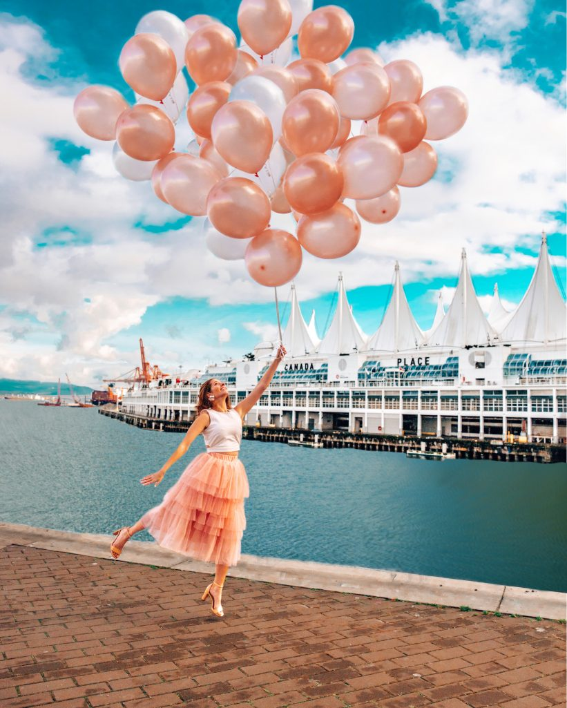 Girl Flying with Balloons at Canada Place Vancouver