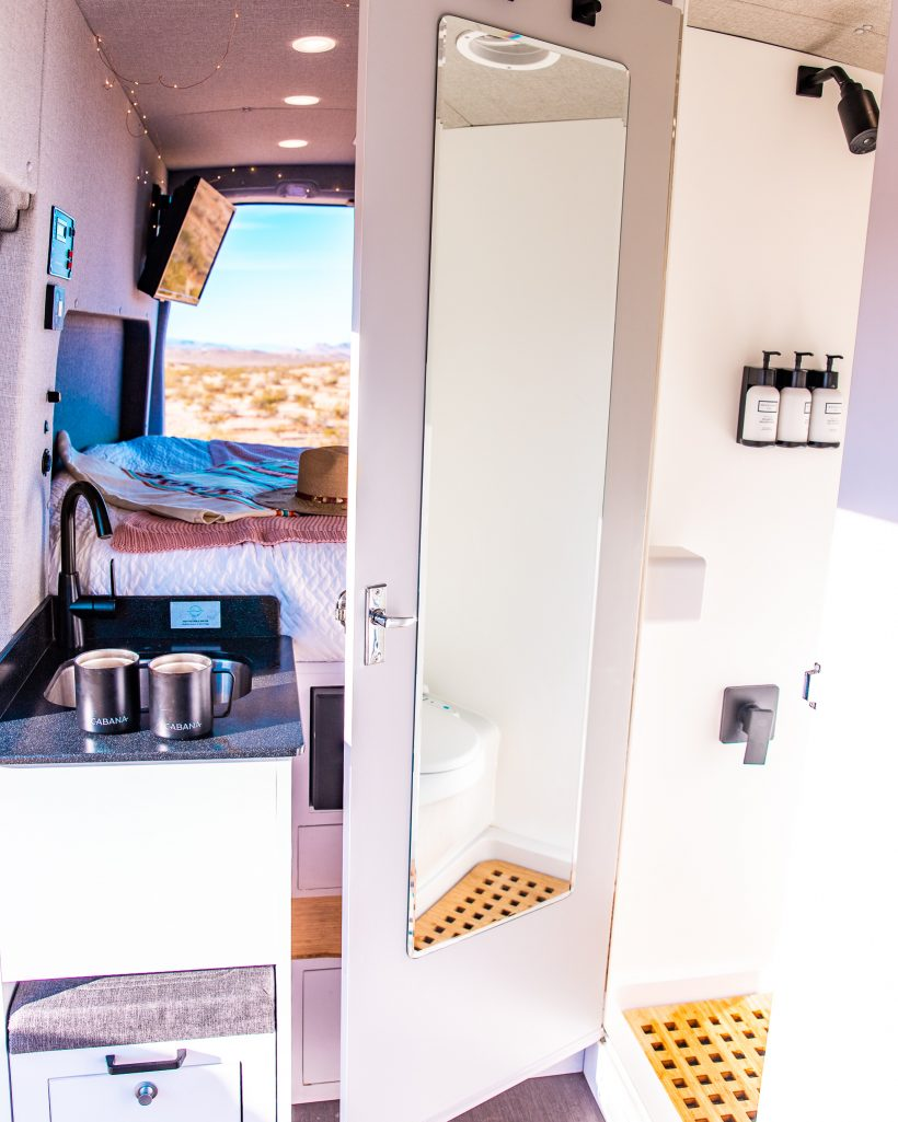 Interior of Cabana van showing the shower, bathroom, and kitchen