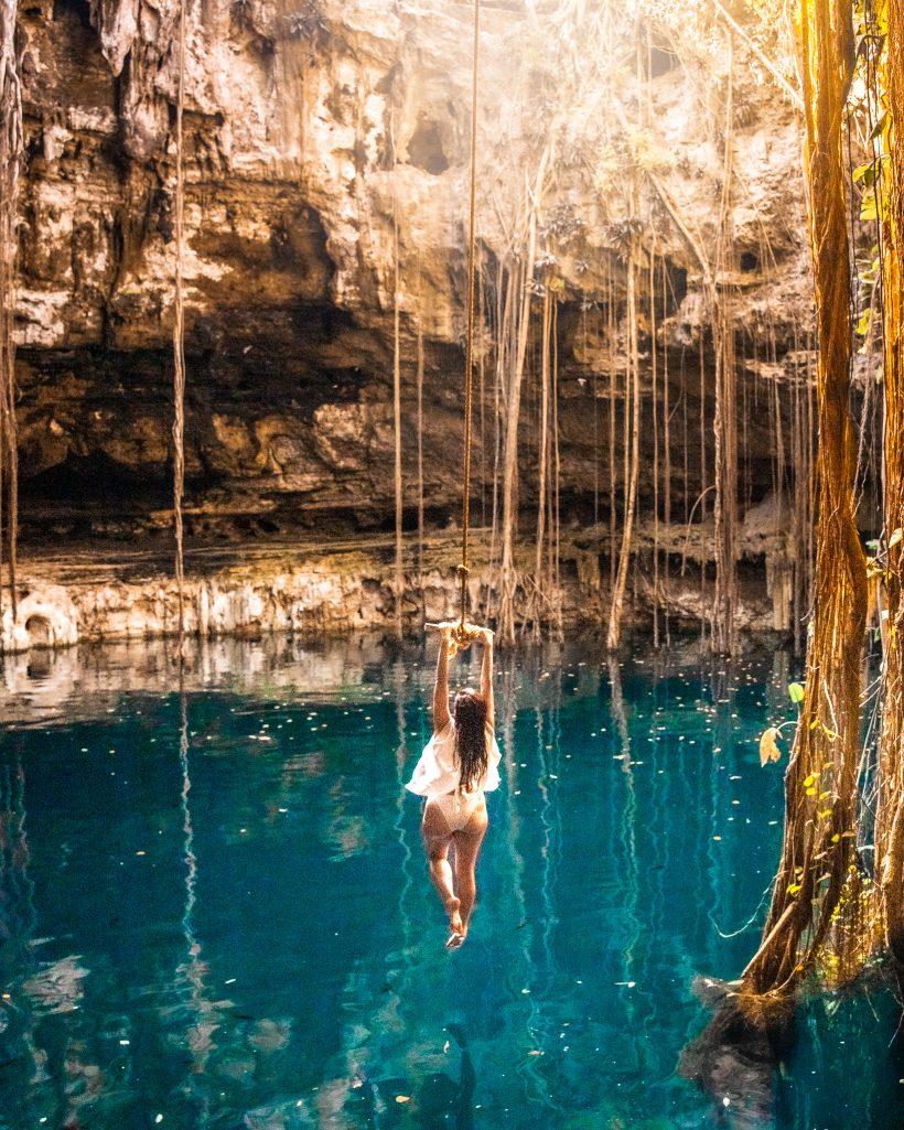 Bettina Swinging at Cenote Oxman Yucatan